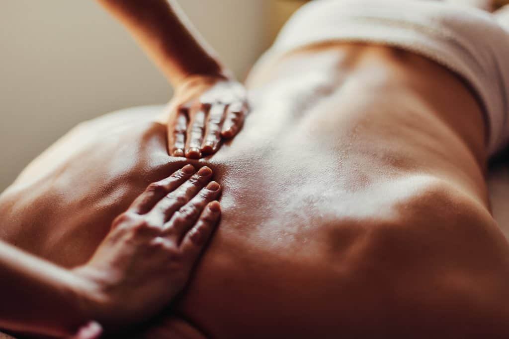 Close-up of massage therapist's hands on a client's back